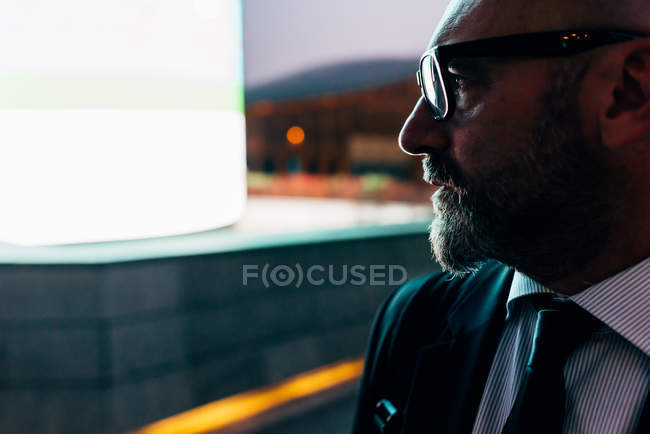 Profile of mature businessman in eyeglasses outdoor — Stock Photo
