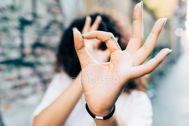 Young woman making hands gestures, Milan, Italy — Stock Photo