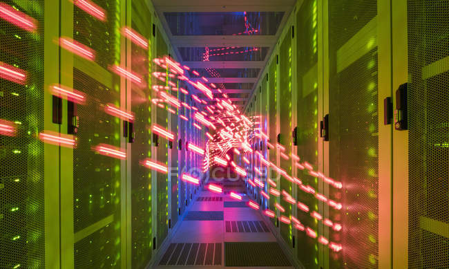 Interior of data centre, lights trails showing travelling data — Stock Photo