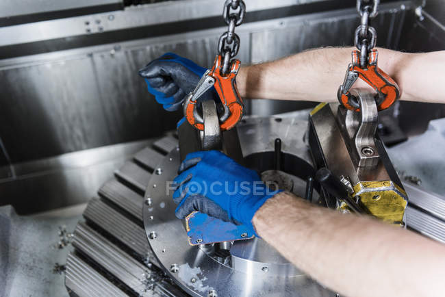 Close up of worker using industrial equipment in factory — Stock Photo