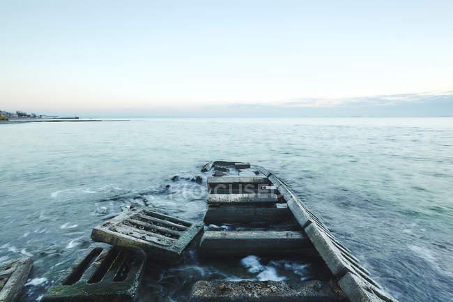 Concrete slabs of derelict pier in sea, Odessa, Odessa Oblast, Ukraine, Europe — Stock Photo