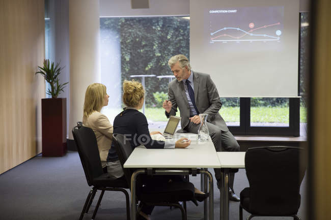 Colleagues working together in conference room — Stock Photo