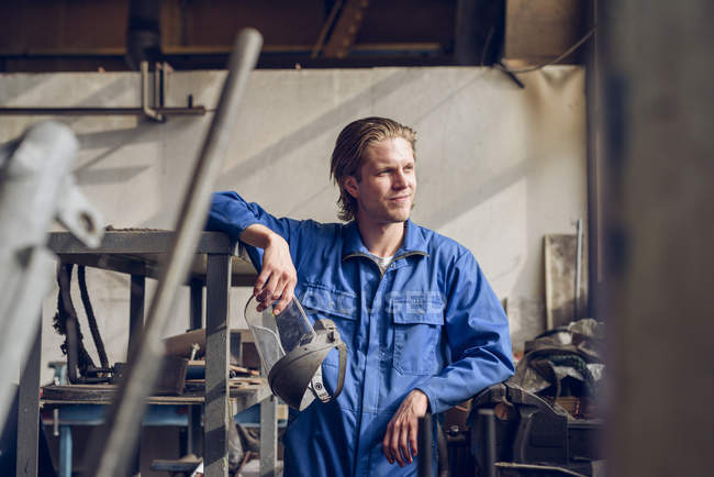 Portrait of factory worker, wearing protective clothing, in manufacturing plant — Stock Photo