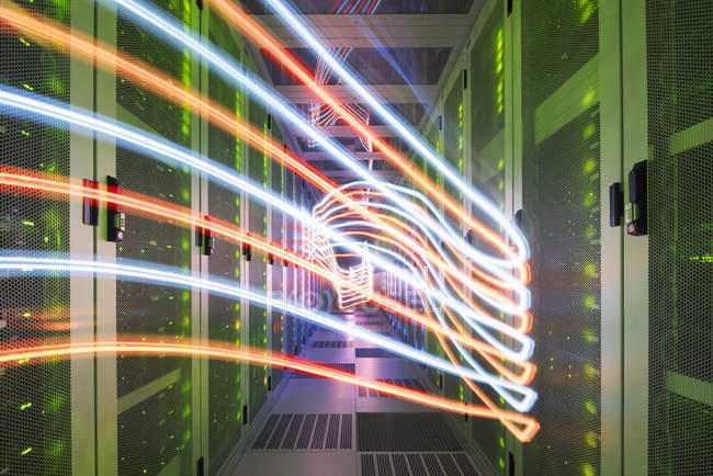 Interior of data center with lights trails showing data way — Stock Photo
