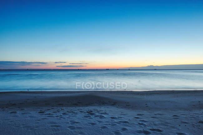 Sunset over sea from beach Odessa, Odessa Oblast, Ukraine, Europe — Stock Photo