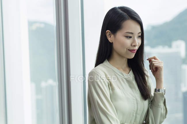 Portrait of businesswoman looking away smiling — Stock Photo