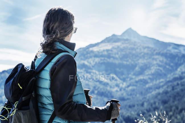 Female Hiker looking away at view of mountain, Madonna di Pietralba, Trentino-Alto Adige, Italy, Europe — Stock Photo
