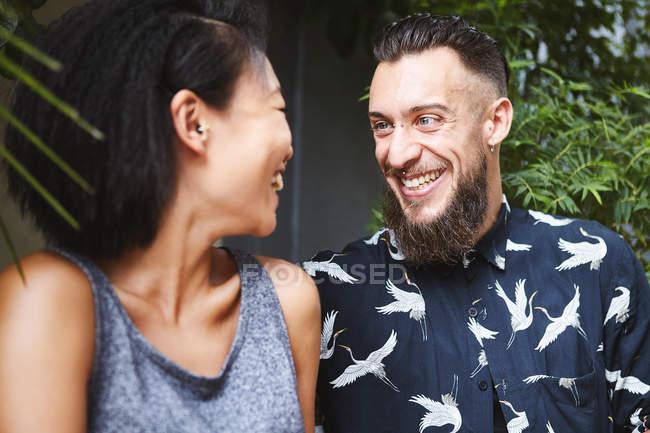 Multi ethnic couple laughing, Shanghai French Concession, Shanghai, China — Stock Photo