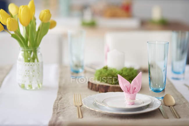 Bunny ear napkin at easter table place setting — Stock Photo