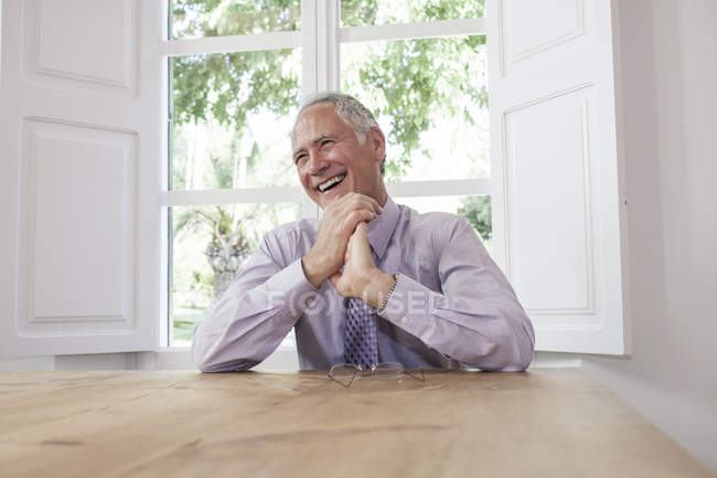 Businessman looking away laughing — Stock Photo