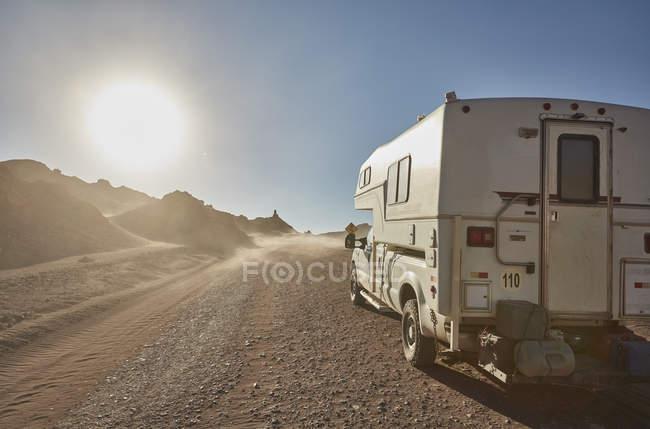 Campervan parked on desert dirt track, San Pedro de Atacama, Chile — Stock Photo