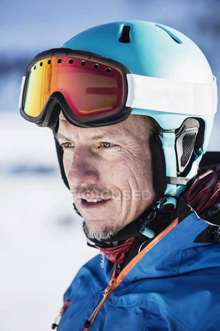 Portrait of skier in helmet and ski goggles — Stock Photo
