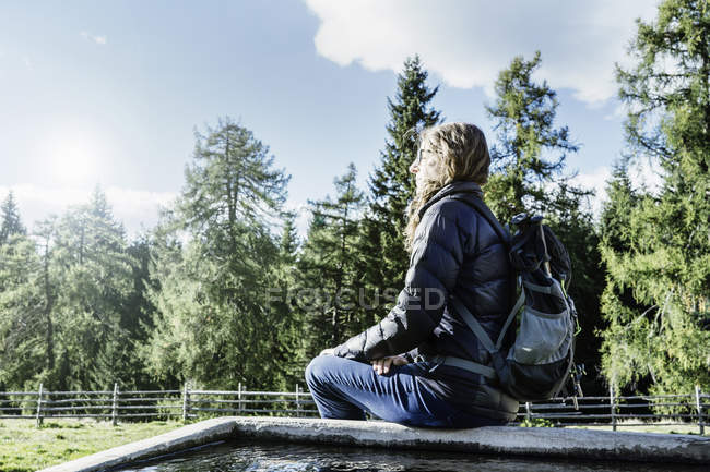 Hiker sitting away at view, Madonna di Pietralba, Trentino-Alto Adige, Italy, Europe — стоковое фото