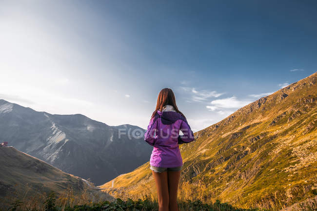 Rear view of young woman looking on mountain landscape, Draja, Vaslui, Romania — Stock Photo