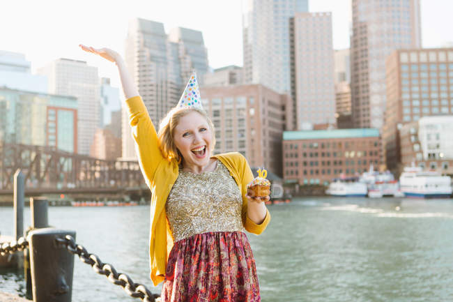 Young woman in party hat on quayside, Boston, Massachusetts, USA — Stock Photo