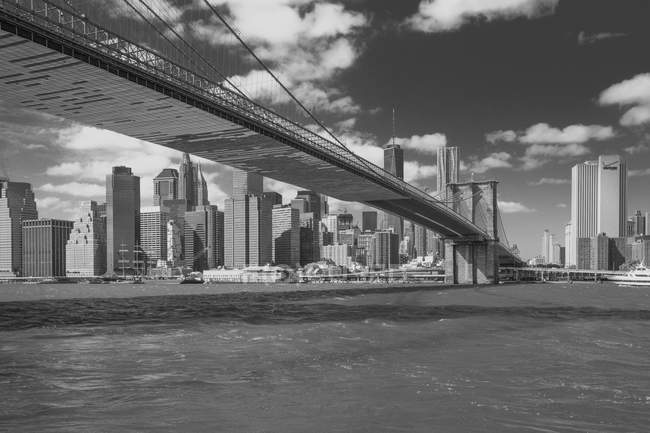Cityscape with Brooklyn Bridge and skyscrapers, B&W, New York, USA — Stock Photo
