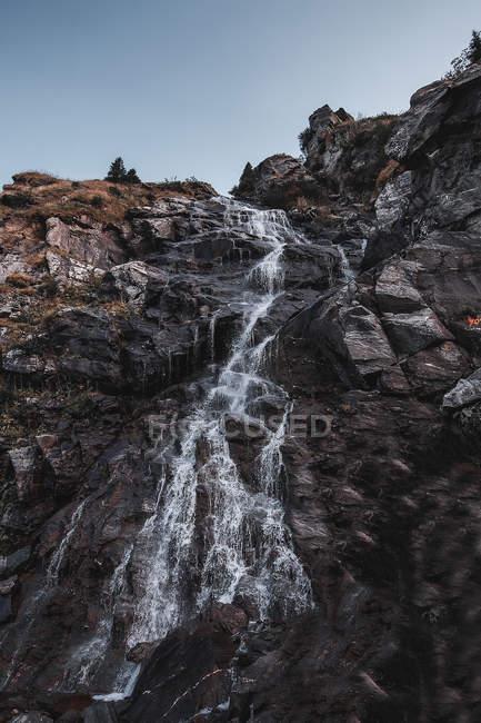 Waterfall moving down over rockface, Draja, Vaslui, Romania — Stock Photo