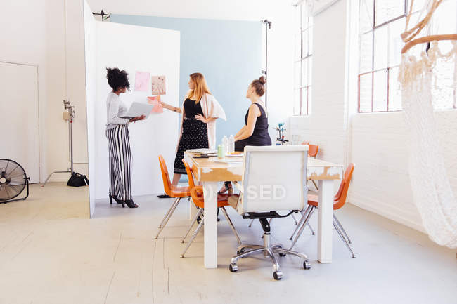 Designers in creative studio discussing swatches — Stock Photo