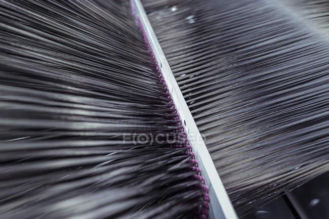 Carbon fibre thread on loom in carbon fibre production facility — Stock Photo