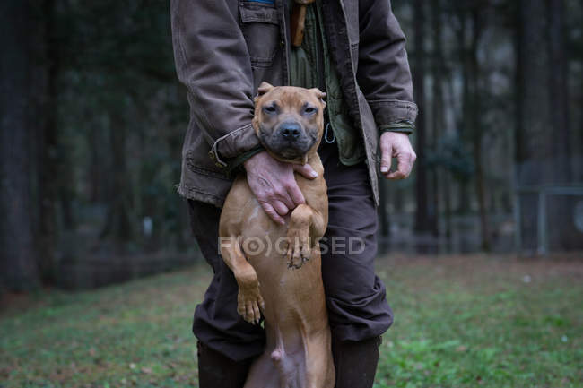 Man and pet dog standing on hind legs — Stock Photo