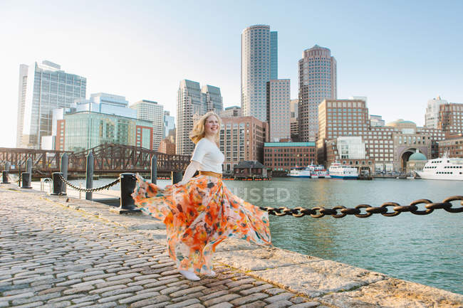 Young woman dancing on quayside, Boston, Massachusetts, USA — Stock Photo