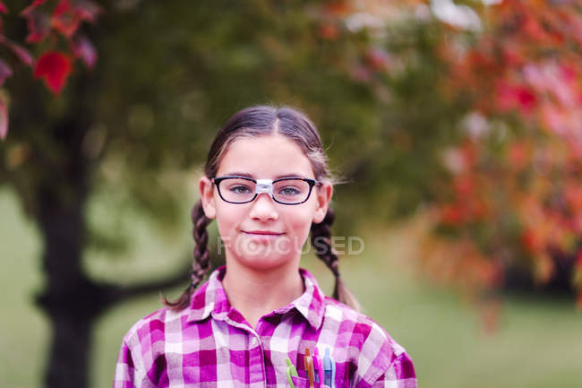 Girl with plaits and broken glasses dressed up as nerd — Stock Photo
