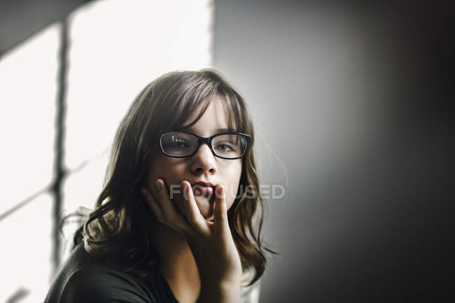 Portrait of girl in eyeglasses daydreaming — Stock Photo
