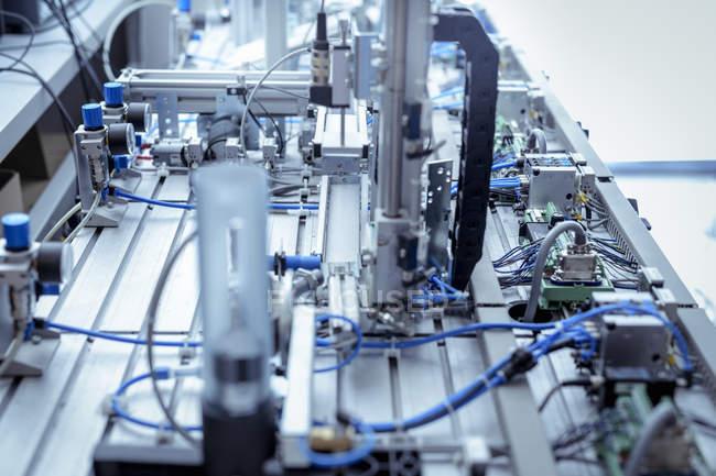 Production line simulation equipment in robotics facility — Stock Photo