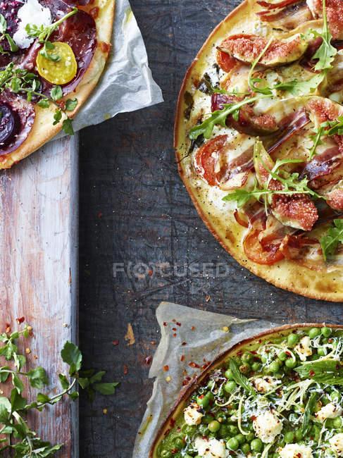 Top view of three fresh pizzas — Stock Photo