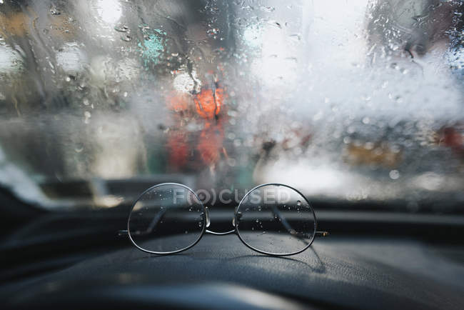 Close-up of Glasses on dashboard, differential focus — Stock Photo