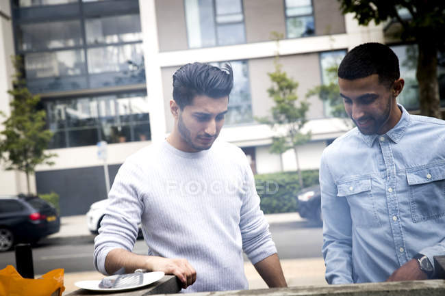 Two friends cooking barbecue outdoor — Stock Photo
