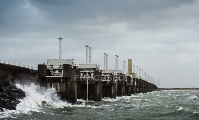 Steel valves at Neeltje-Jans Oosterschelde flood barrier closed to protect the Netherlands during a storm — Stock Photo