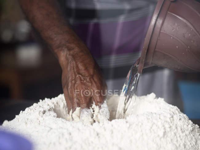 Man preparing roti dough — Stock Photo