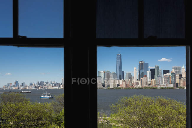 Silhouetted window frame view of Manhattan cityscape and skyline, Times Square, New York, USA — Stock Photo