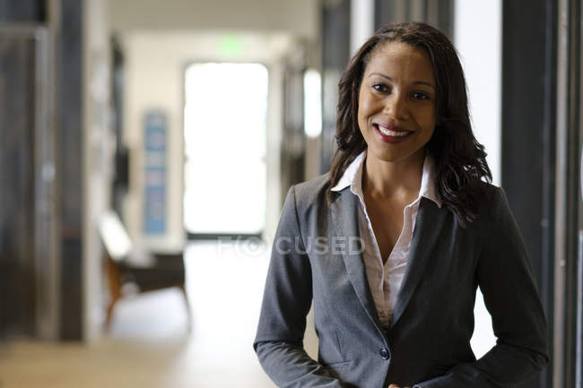 Portrait of businesswoman smiling in office space — Stock Photo
