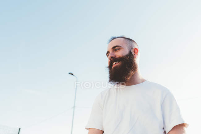 Portrait of young bearded man looking away — Stock Photo