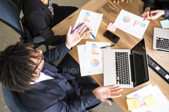 Overhead view of business people working together — Stock Photo