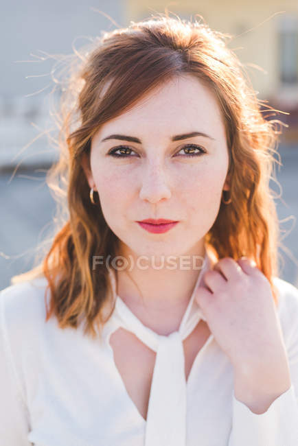 Portrait of beautiful young woman with hand in red hair — Stock Photo
