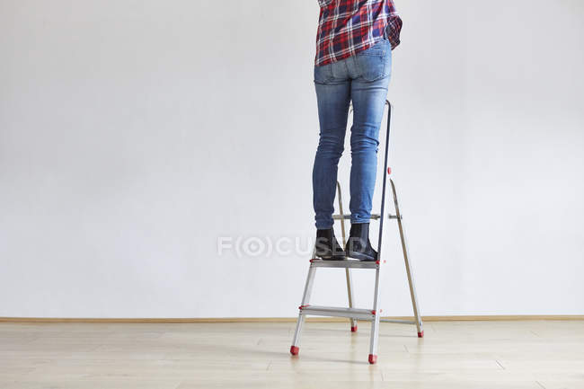 Person standing on ladder — Stock Photo