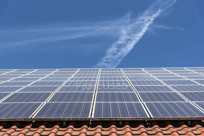 Solar panels on roof, low angle view, Munich, Germany — Stock Photo