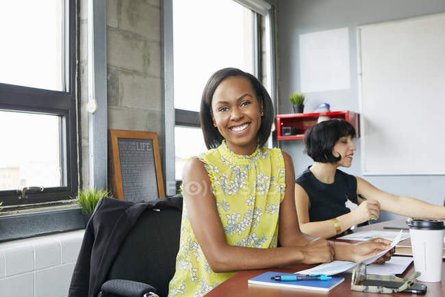 Two businesswomen sitting in meeting room — Stock Photo