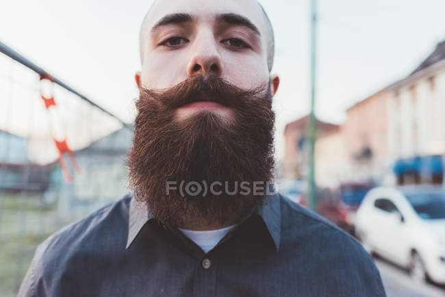 Portrait of young bearded man looking at camera — Stock Photo