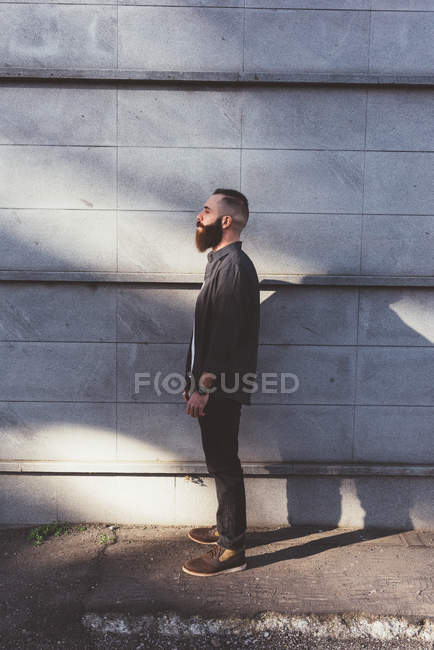 Side view portrait of young bearded man — Stock Photo