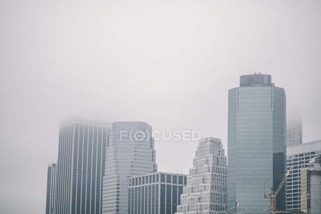 City skyline in fog, New York, USA — Stock Photo