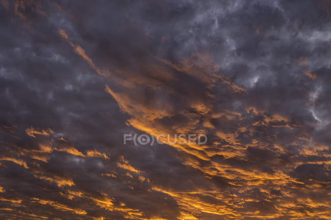 Glowing dramatic cloudscape at sunset — Stock Photo