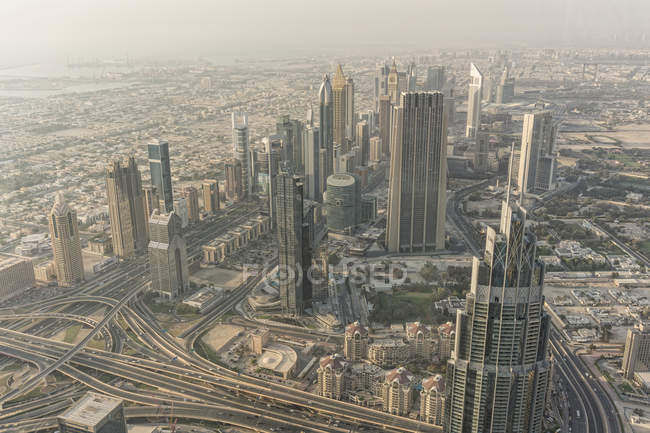 High angle hazy grey cityscape, Dubai, United Arab Emirates — Stock Photo