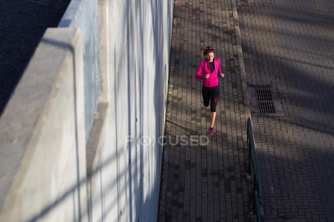 High angle view of young woman jogging — Stock Photo