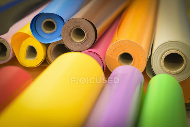 Rolls of colourful vinyl in factory — Stock Photo