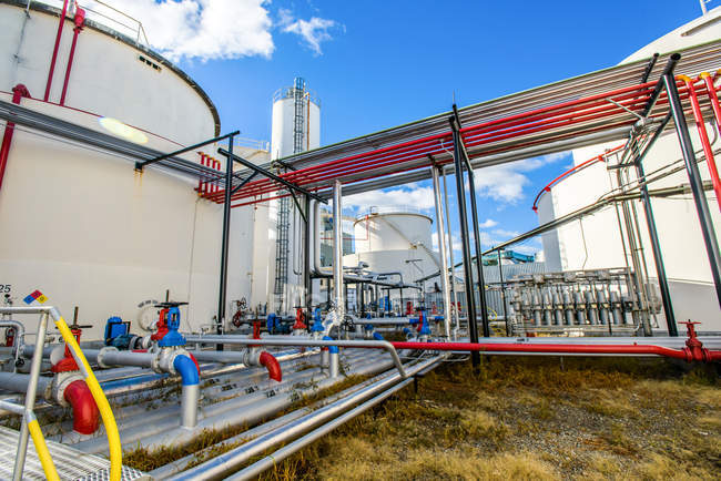 Industrial piping valves at biofuel plant — Stock Photo