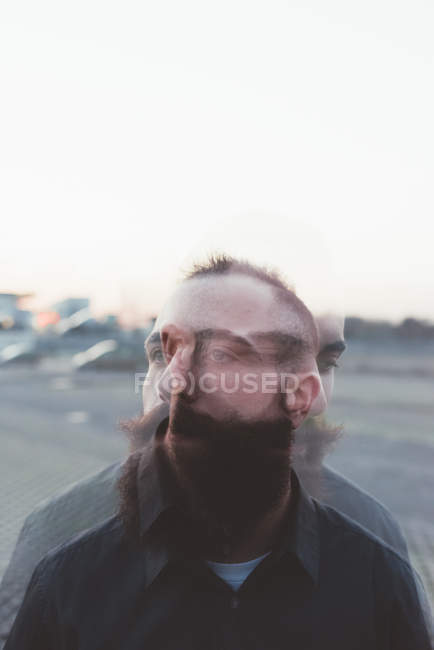Double exposure of bearded man outdoors — Stock Photo